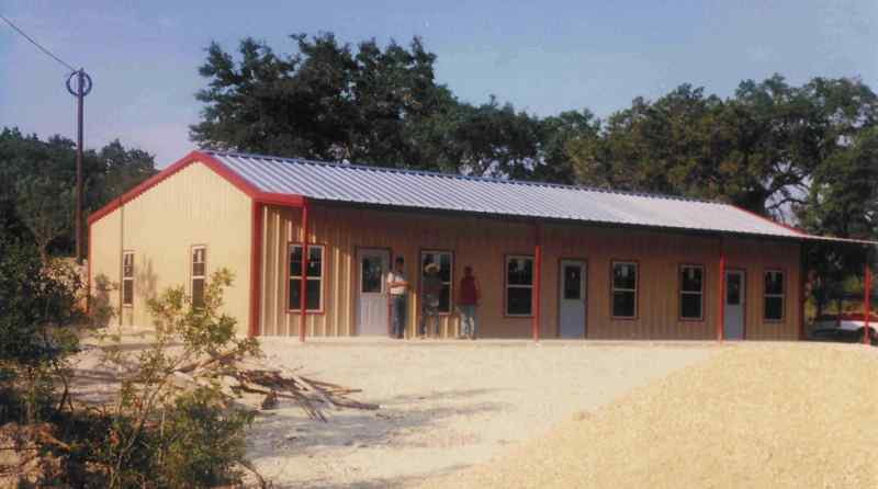 2400 sq foot custom home plus wrap around porches with a Metal houses texas